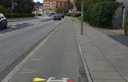 Lysende vejskilte skal påminde cyklisterne